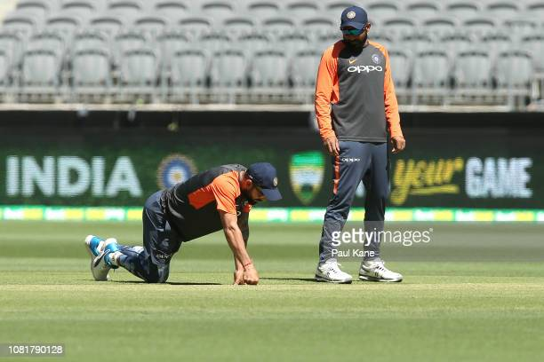 Virat Kohli and Mohammed Shami inspect the pitch during an India training session at Optus Stadium on December 13 2018 in Perth Australia