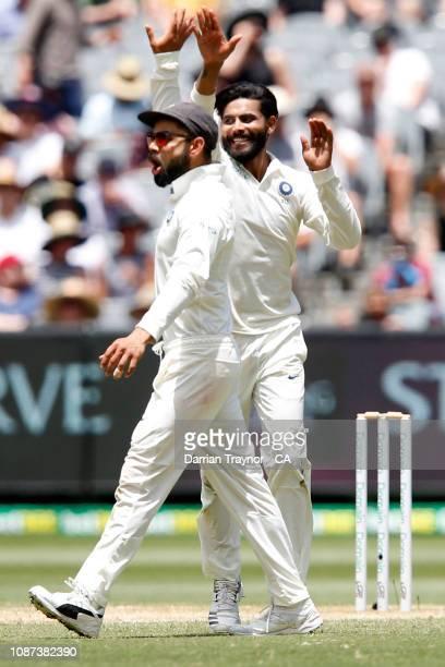 Virat Kohli and Ravindra Jadeja of India celebrate the wicket of Mitchell Marsh of Australia during day three of the Third Test match in the series...