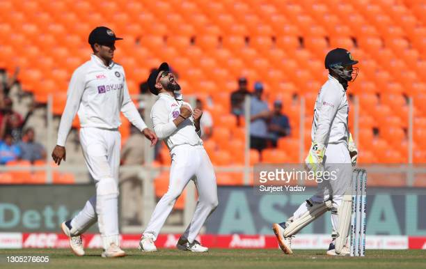 Virat Kohli and Rishabh Pant of India celebrate the wicket of Jack Leach of England during Day One of the 4th Test Match between India and England at...