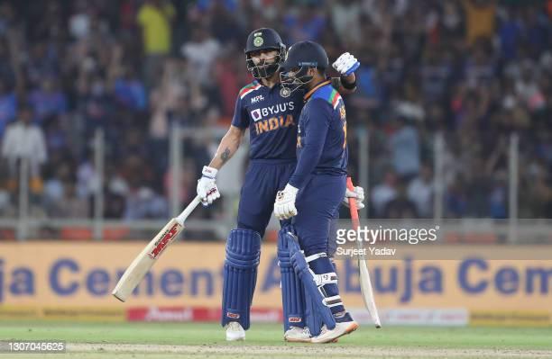 Virat Kohli and Rishabh Pant of India interact during the 2nd T20 International match between India and England at Narendra Modi Stadium on March 14,...