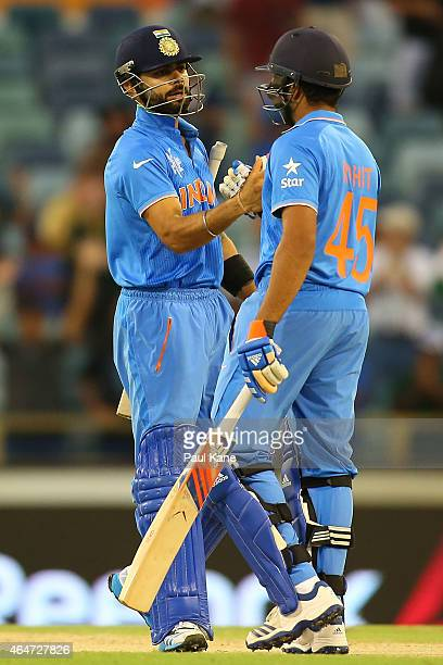 Virat Kohli and Rohit Sharma of India celebrate after winning the 2015 ICC Cricket World Cup match between India and the United Arab Emirates at WACA...
