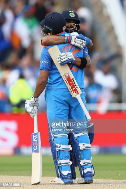 Virat Kohli and Rohit Sharma of India celebrate victory by 9 wickets during the ICC Champions Trophy SemiFinal match between Bangladesh and India at...