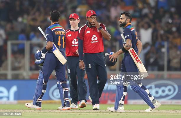 Virat Kohli and Shreyas Iyer of India, alongside Eoin Morgan and Chris Jordan of England interact following the 2nd T20 International match between...