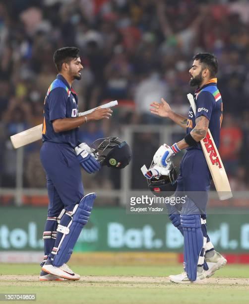 Virat Kohli and Shreyas Iyer of India interact following the 2nd T20 International match between India and England at Narendra Modi Stadium on March...