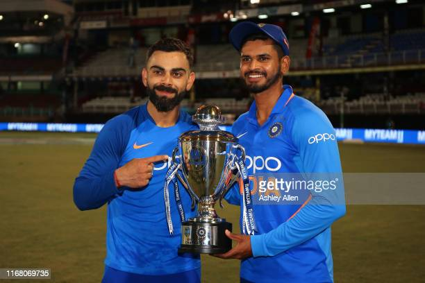 Virat Kohli and Shreyas Iyer of India with the winner's trophy during the third MyTeam11 ODI between the West Indies and India at the Queen's Park...