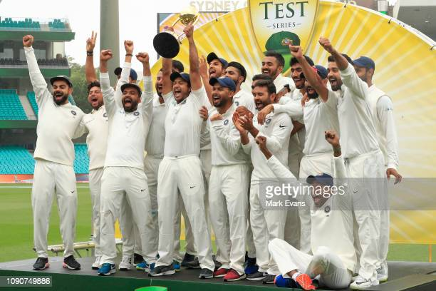 Virat Kohli , and The Indian Cricket Team celebrate winning the Border Gavaskar trophy during day five of the fourth Test match in the series between...