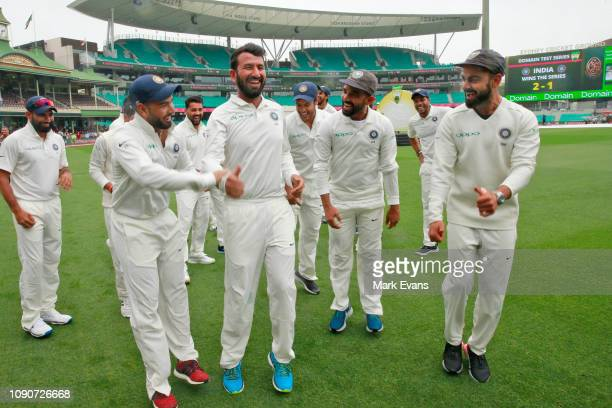 Virat Kohli and the Indian cricket team celebrate winning the series and the Border–Gavaskar Trophy during day five of the Fourth Test match in the...