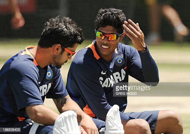 Virat Kohli and Umesh Yadav from India rest during a practice session at the Sydney Cricket Ground in Sydney on January 2 2012 India plays Australia...