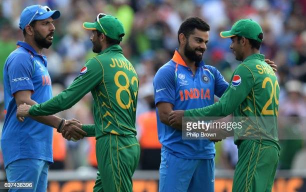 Virat Kohli and Yuvraj Singh of India shakes hands with Shadab Khan and Junaid Khan of Pakistan after Pakistan won the ICC Champions Trophy final...