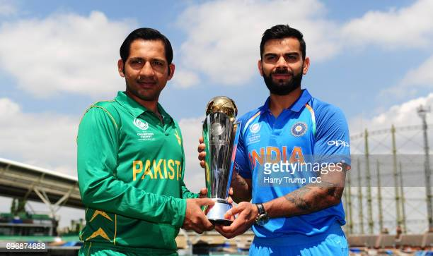 Virat Kohli Captain of India and Sarfraz Ahmed Captain of Pakistan pose with the trophy during the Previews ICC Champions Trophy Final at The Kia...