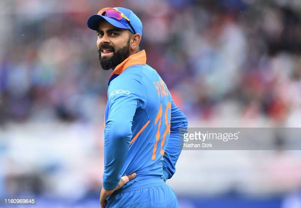Virat Kohli , Captain of India looks on during the Semi-Final match of the ICC Cricket World Cup 2019 between India and New Zealand at Old Trafford...