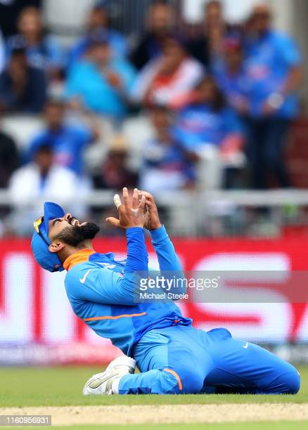 Virat Kohli Captain of India reacts after an attempted run out during the SemiFinal match of the ICC Cricket World Cup 2019 between India and New...