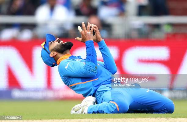 Virat Kohli, Captain of India reacts after an attempted run out during the Semi-Final match of the ICC Cricket World Cup 2019 between India and New...