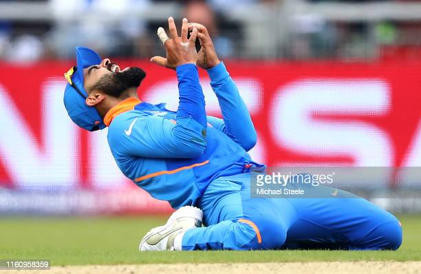 Virat Kohli, Captain of India reacts to an attempted run out during the Semi-Final match of the ICC Cricket World Cup 2019 between India and New...