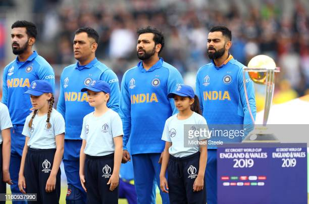 Virat Kohli, Captain of India singa his national anthem ahead of the Semi-Final match of the ICC Cricket World Cup 2019 between India and New Zealand...