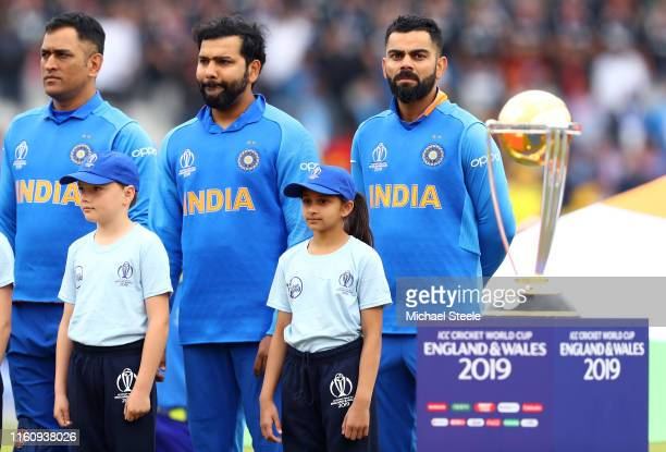 Virat Kohli Captain of India singa his national anthem ahead of the SemiFinal match of the ICC Cricket World Cup 2019 between India and New Zealand...