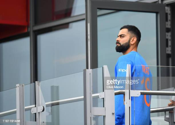 Virat Kohli , Captain of India walks back to the changing room after losing the Semi-Final match of the ICC Cricket World Cup 2019 between India and...