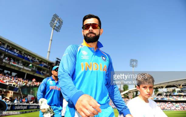 Virat Kohli Captain of India walks out for the start during the ICC Champions Trophy Final match between India and Pakistan at The Kia Oval on June...