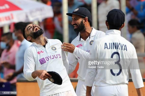 Virat Kohli, Cheteshwar Pujara and Ajinkya Rahane of India celebrate victory after Day Three of the 4th Test Match between India and England at the...
