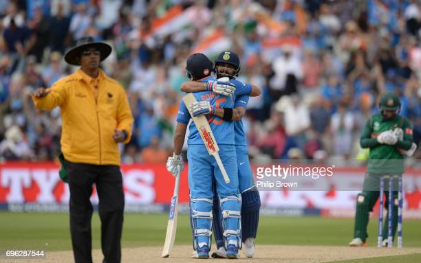 Virat Kohli embraces Rohit Sharma of India after India won the ICC Champions Trophy match between Bangladesh and India at Edgbaston cricket ground on...