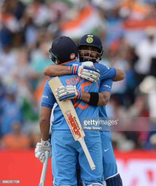 Virat Kohli embraces Rohit Sharma of India after India won the ICC Champions Trophy match between Bangladesh and India at Edgbaston cricket ground on...
