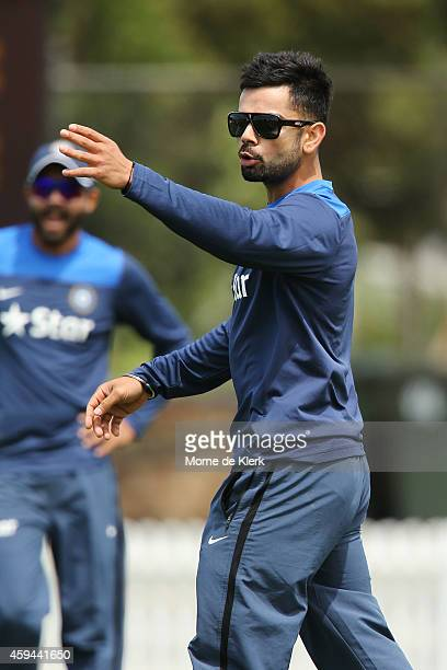 Virat Kohli gives instructions to a teammate during a training session for the Indian cricket team at Gliderol Stadium on November 23 2014 in...