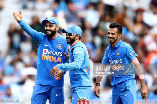 Virat Kohli, Kedar Jadhav and Yuzvendra Chahal of India celebrate the wicket of Tim Southee of the Black Caps during game two of the One Day...