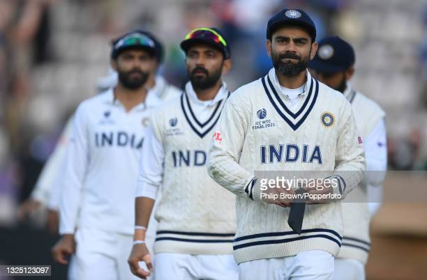 Virat Kohli leads his team including Ajikya Rahane and Ravindra Jadeja from the field after the ICC World Test Championship Final between India and...