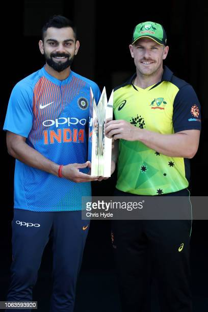 Virat Kohli of India and Aaron Finch of Australia pose during an International Twenty20 series media opportunity at The Gabba on November 20 2018 in...