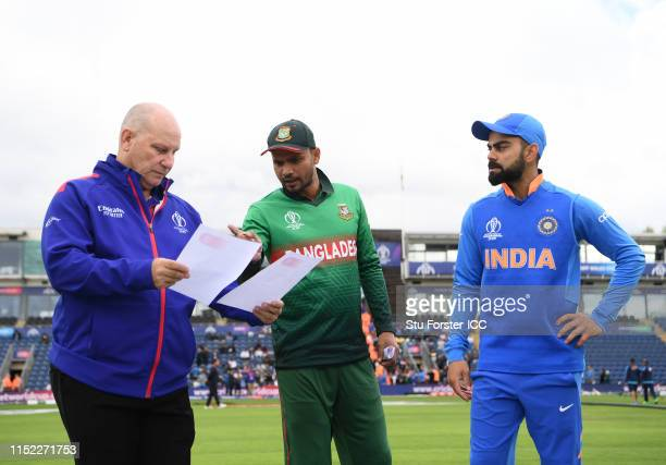 Virat Kohli of India and Bangladesh captain Mashrafe Mortaza exchange team sheets with match referee Andy Pycroft before the ICC Cricket World Cup...