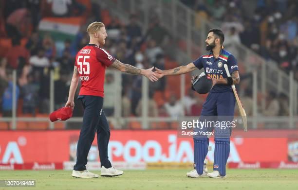 Virat Kohli of India and Ben Stokes of England interact following the 2nd T20 International match between India and England at Narendra Modi Stadium...