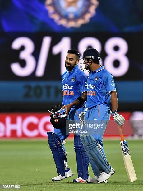 Virat Kohli of India and MS Dhoni of India walk from the field after the completion of their innings during game one of the Twenty20 International...