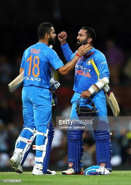 Virat Kohli of India and Dinesh Karthik of India celebrate winning the International Twenty20 match between Australia and India at Sydney Cricket...