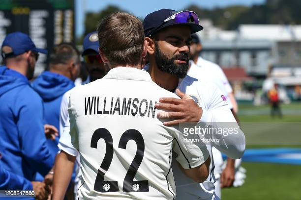 Virat Kohli of India and Kane Williamson of New Zealand shake hands at the conclusion of day four of the First Test match between New Zealand and...