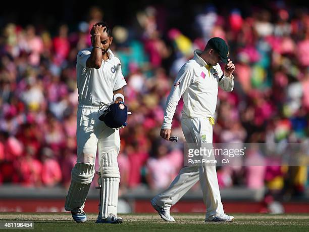 Virat Kohli of India and Steve Smith of Australia levae the ground at stumps during day three of the Fourth Test match between Australia and India at...