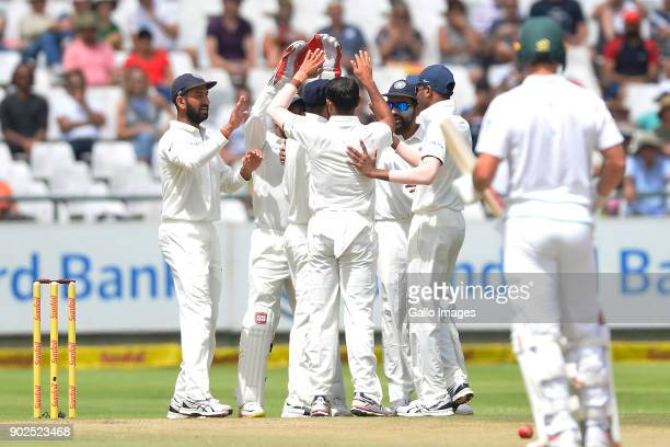 Virat Kohli of India and team celebrate the wicket of Kagiso Rabada of South Africa during day 4 of the 1st Sunfoil Test match between South Africa...