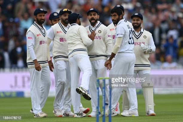 Virat Kohli of India and team mates celebrate the wicket of Joe Root of England during the Second LV= Insurance Test Match: Day Five between England...