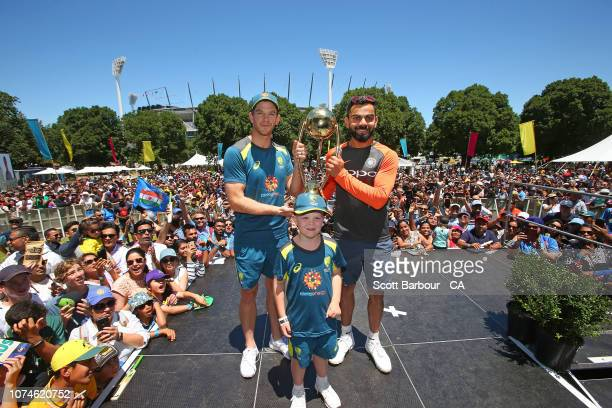 Virat Kohli of India and Tim Paine of Australia along with Archie Shiller from the Make A Wish foundation who will be cocaptain on Boxing Day pose...