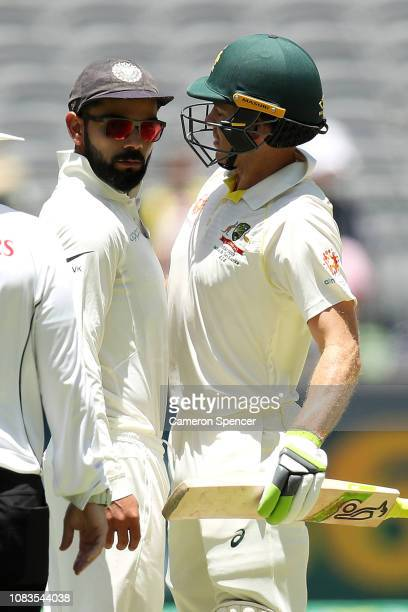 Virat Kohli of India and Tim Paine of Australia bump into each other during day four of the second match in the Test series between Australia and...