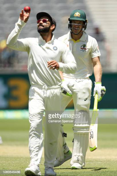 Virat Kohli of India and Tim Paine of Australia exchange words during day four of the second match in the Test series between Australia and India at...