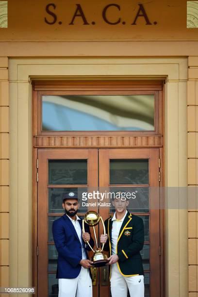 Virat Kohli of India and Tim Paine of Australia pose with the BorderÐGavaskar Trophy ahead of the Test series between Australia and India at Adelaide...