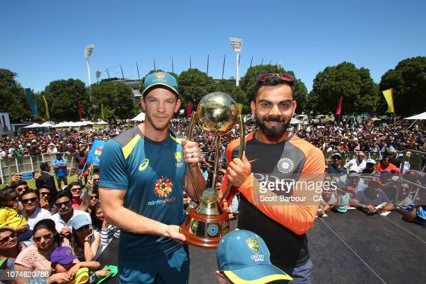 Virat Kohli of India and Tim Paine of Australia pose with the BorderÐGavaskar Trophy ahead of the Boxing Day Test during the Indian Summer Festival...