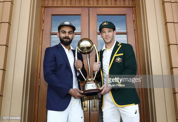 Virat Kohli of India and Tim Paine of Australia pose with the Border–Gavaskar Trophy ahead of the Test series between Australia and India at Adelaide...