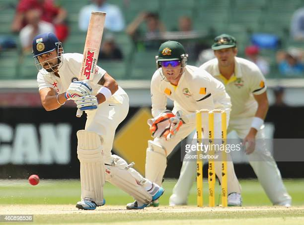 Virat Kohli of India bats as wicketkeeper Brad Haddin and Shane Watson of Australia look on during day five of the Third Test match between Australia...