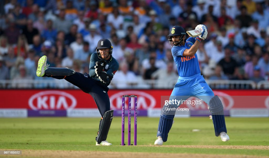 Virat Kohli of India bats watched by Englamd wicketkeeper Jos Buttler during the Royal London One-Day match between England and India at Trent Bridge on July 12, 2018 in Nottingham, England.