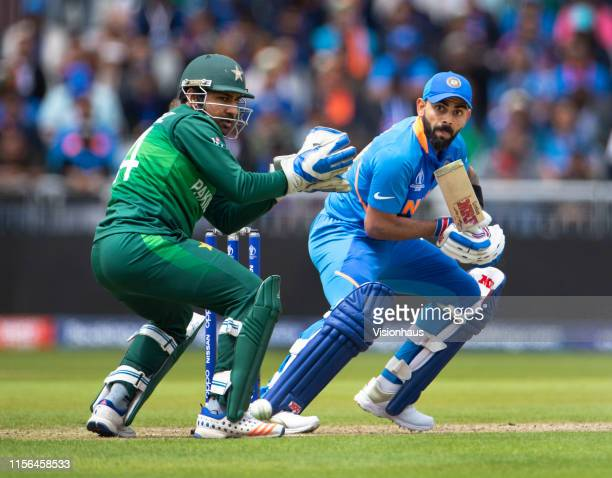 Virat Kohli of India batting with Sarfaraz Ahmed keeping wicket during the Group Stage match of the ICC Cricket World Cup 2019 between Pakistan and...