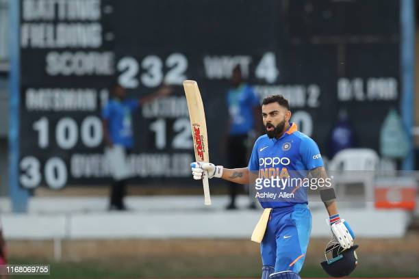 Virat Kohli of India brings up his hundred during the third MyTeam11 ODI between the West Indies and India at the Queen's Park Oval on August 14,...