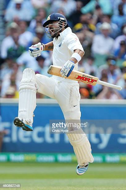 Virat Kohli of India celebrates a century during day three of the Third Test match between Australia and India at Melbourne Cricket Ground on...