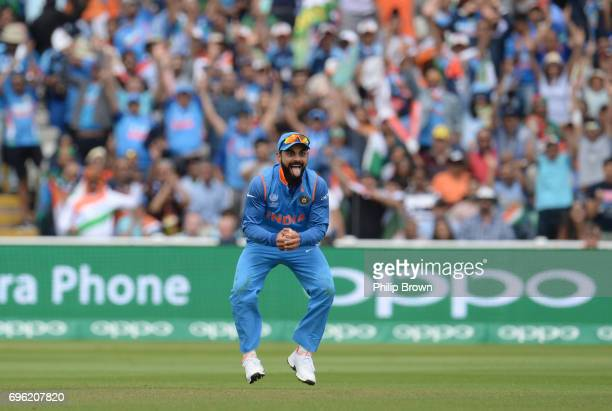 Virat Kohli of India celebrates after catching Mushfiqur Rahim of Bangladesh during the ICC Champions Trophy match between Bangladesh and India at...