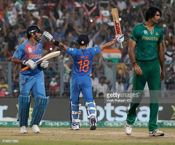 Virat Kohli of India celebrates after India won during the ICC World Twenty20 India 2016 match betweenPakistan and India at Eden Gardens on March...